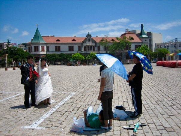 Wedding photoshoot outside St Michael's Cathedral Qingdao Shandong Province China