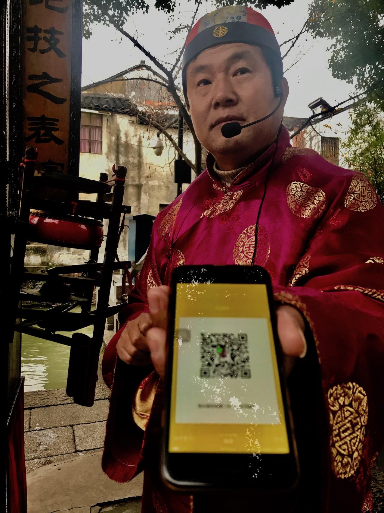 Peep show man Shantang Street Suzhou China