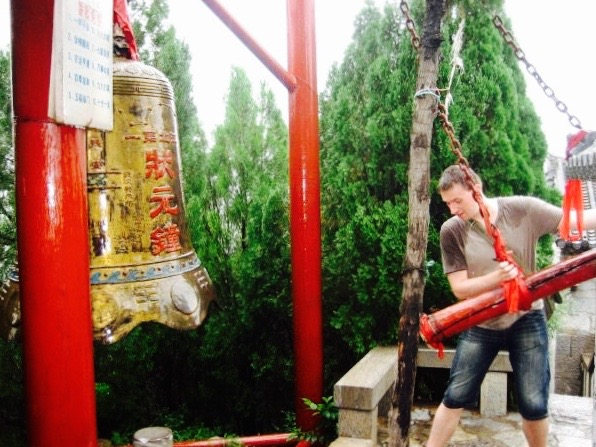 Ringing the bell at Kuixing Pavilion Zhujiayu Village Shandong Province China