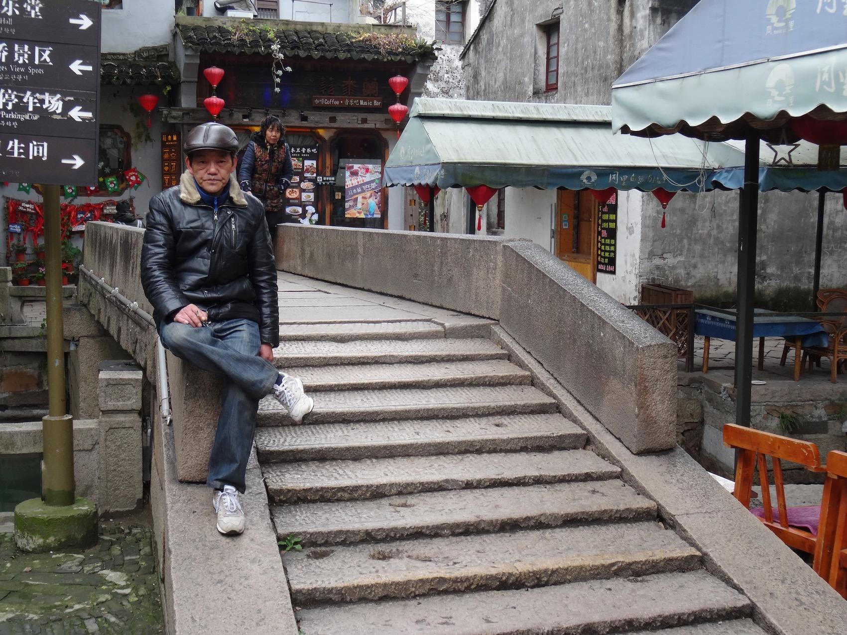 Sittin doin nothin Tongli Water Town Suzhou China