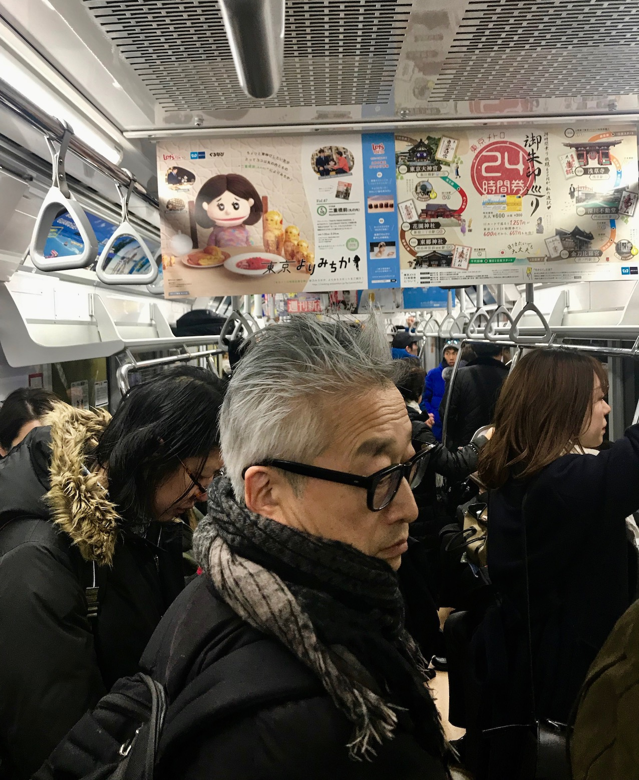 Busy carriage on The Tokyo Subway.