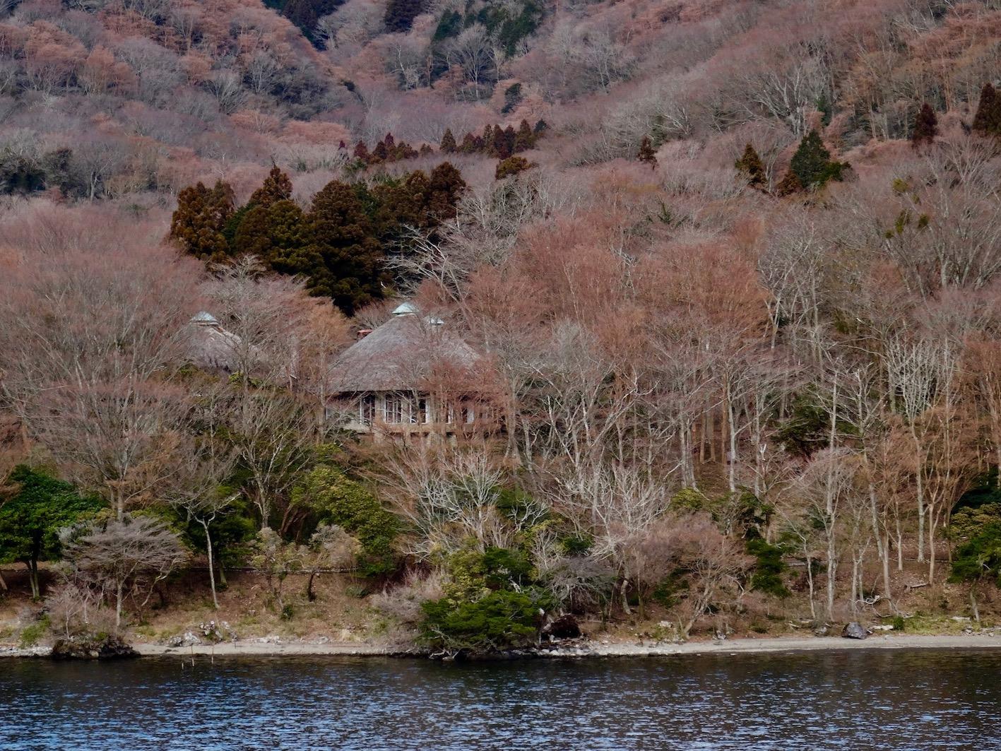 Thatched holiday homes Lake Ashi Japan.