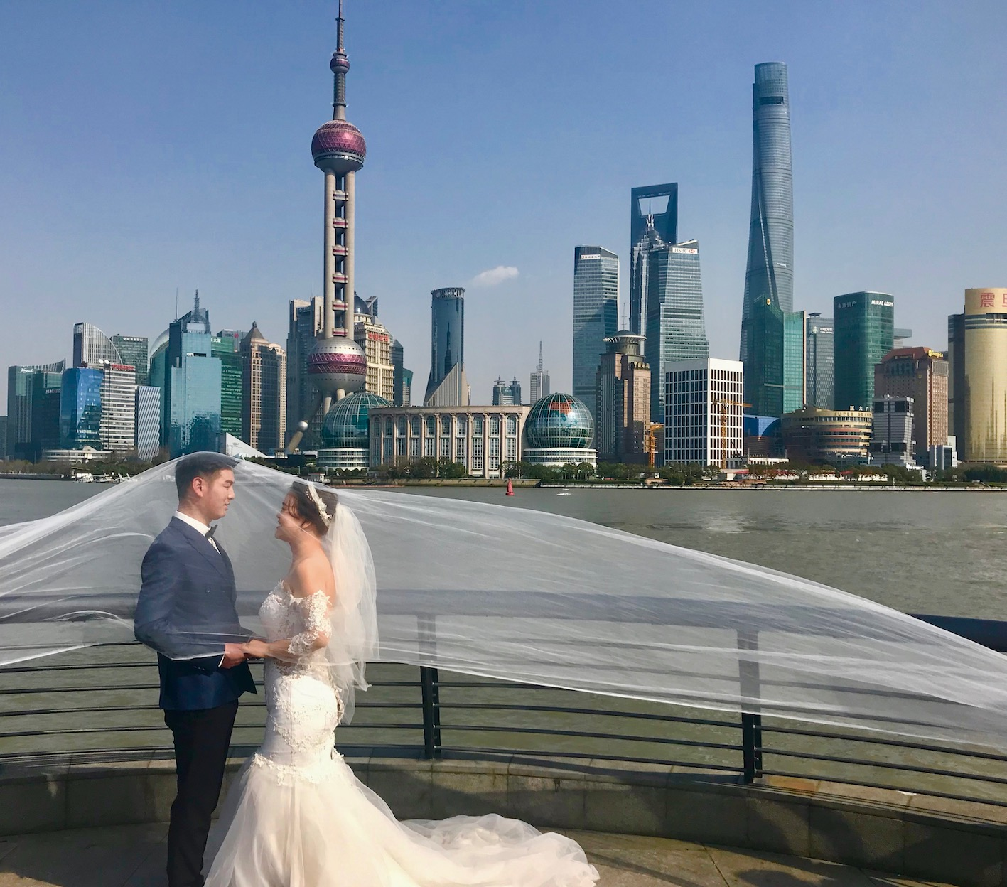 Wedding photos overlooking The Pudong Shanghai.