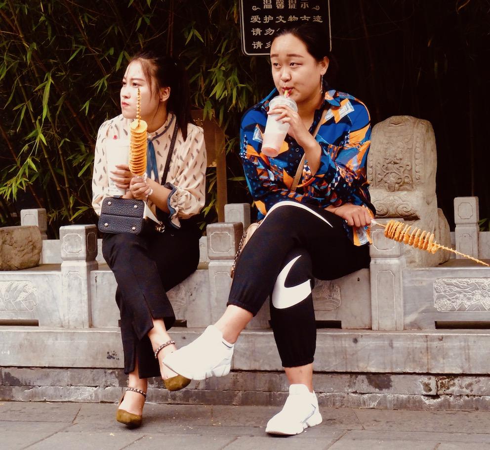 Snacking locals Nanluoguxiang Beijing.