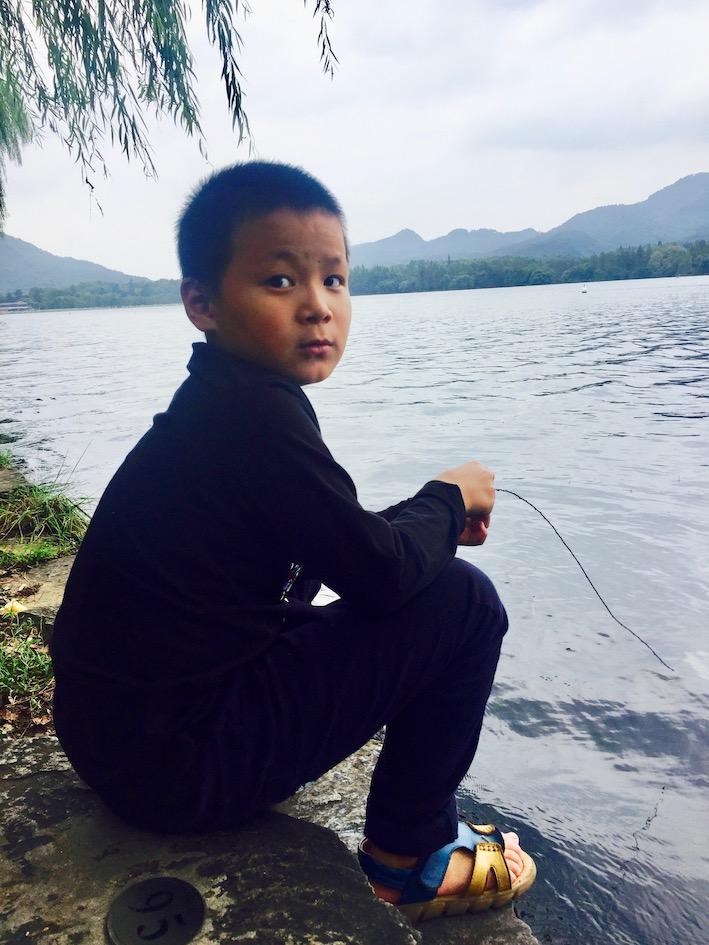 Chinese boy at West Lake Hangzhou.