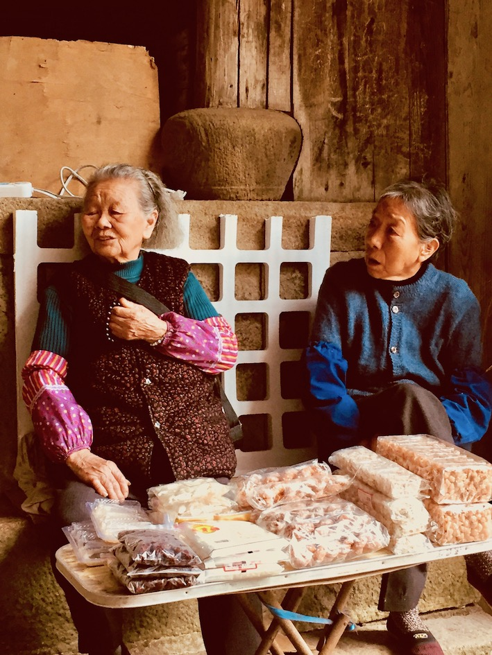 Sweet vendors Beijian Bridge Taishun County China.
