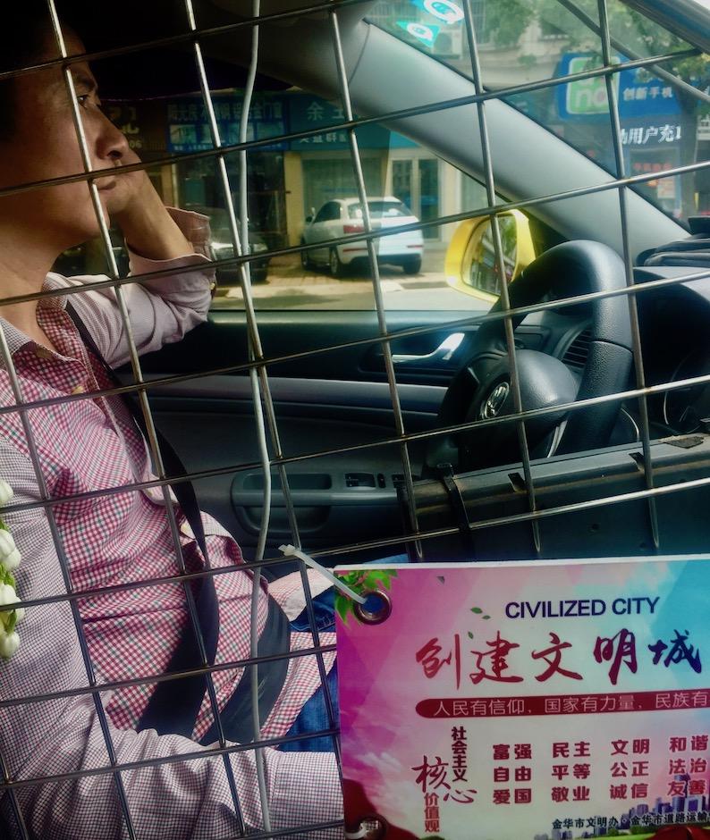 Taxi driver Jinhua Zhejiang Province China.