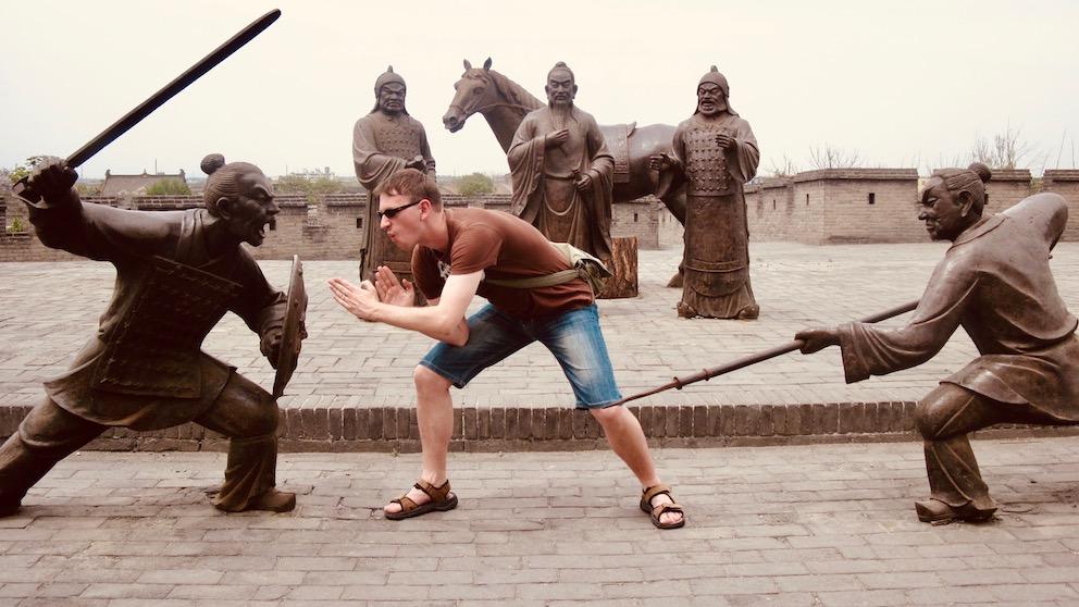 Ancient city wall sculptures Pingyao China.