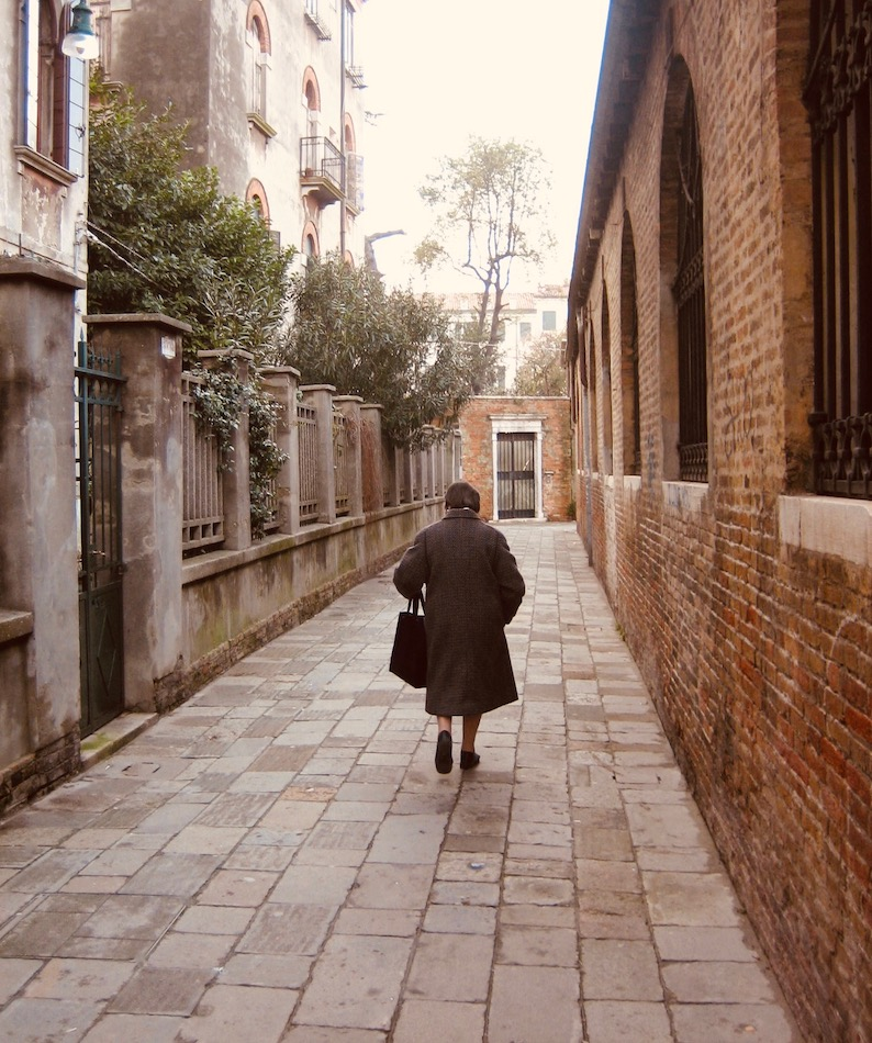 Old woman Venice backstreet.