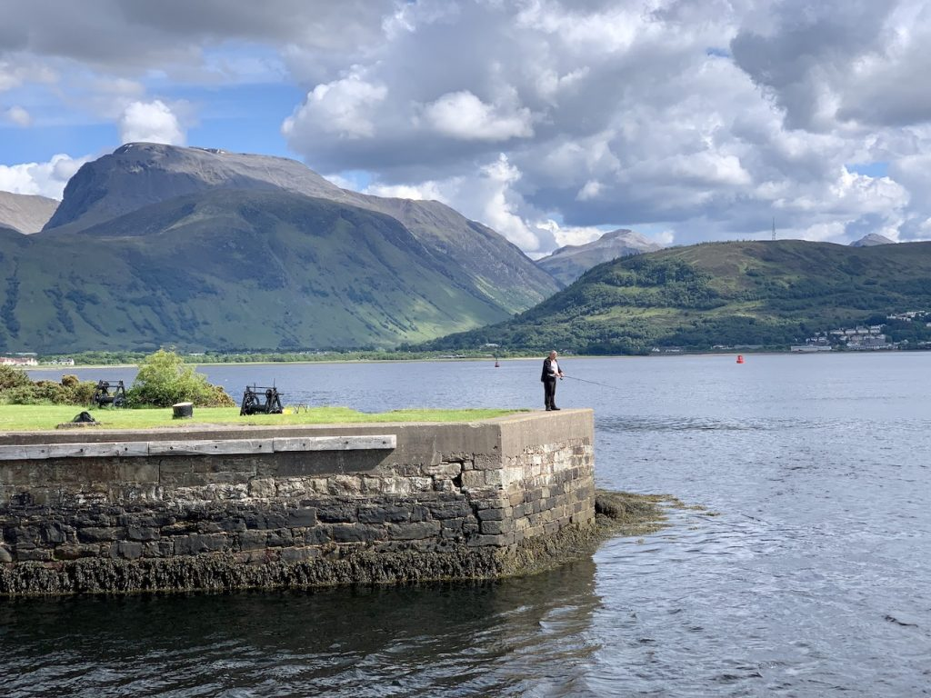 A man fishing at Loch Linnhe Scotland.