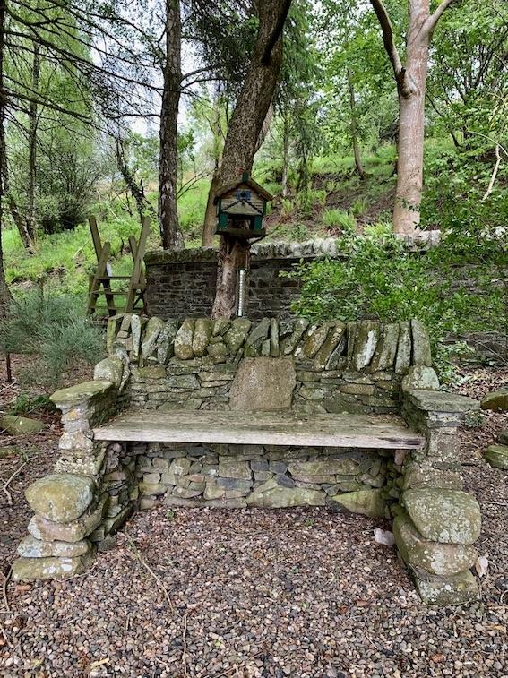 Beautiful stone bench and birdhouse Caddonfoot Parish Church Scotland.