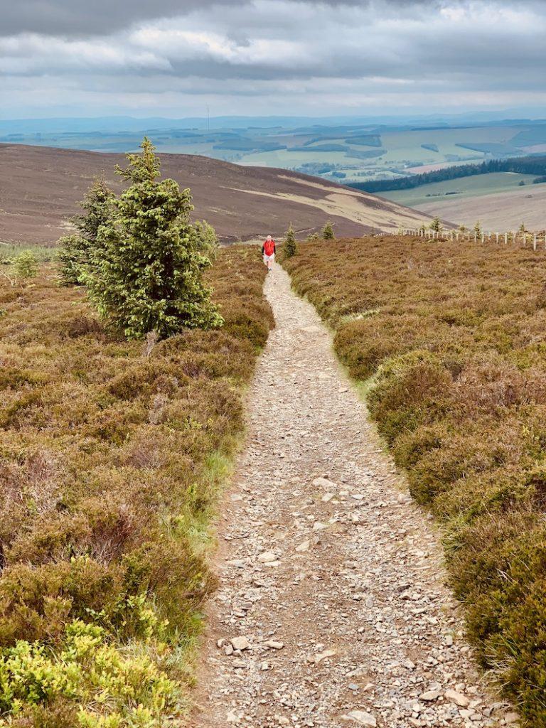 Hiking The Southern Upland Way towards The Three Brethren Scotland.