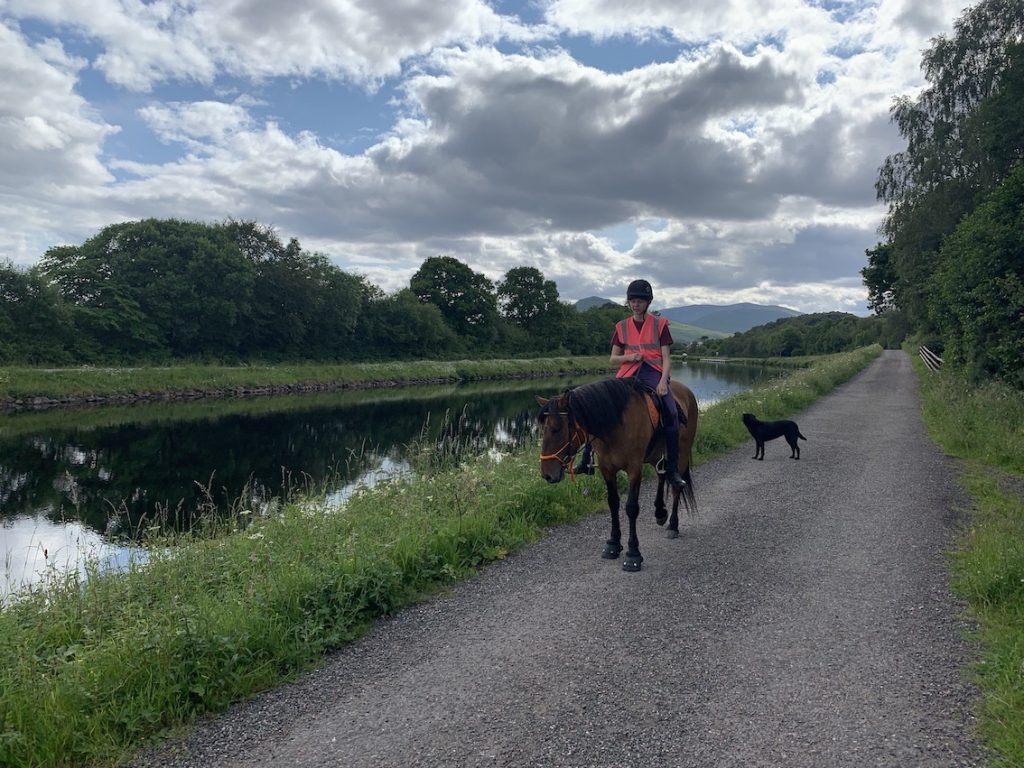 Horse riding along The Great Glen Way Scotland.
