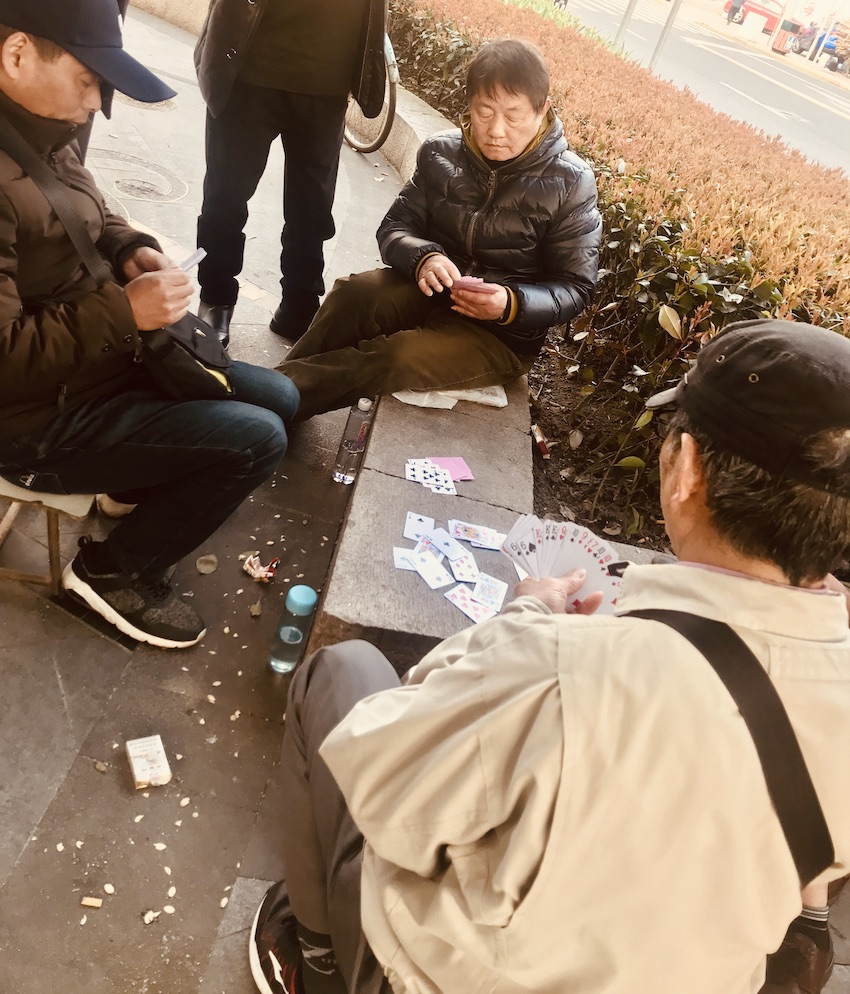 Old men playing cards French Concession Shanghai.