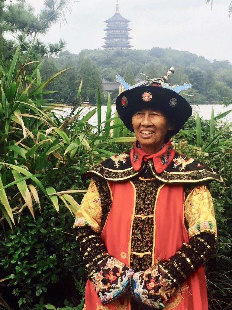 Man in traditional Chinese costume West Lake Hangzhou.
