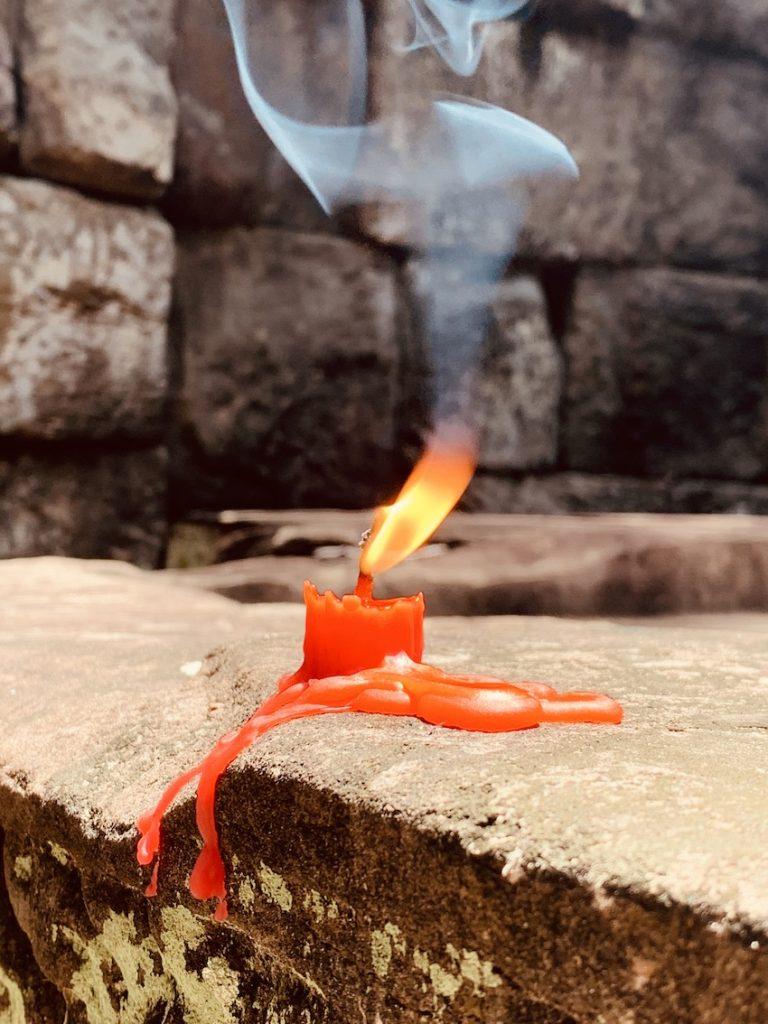 Burning candle Koh Ker Cambodia.