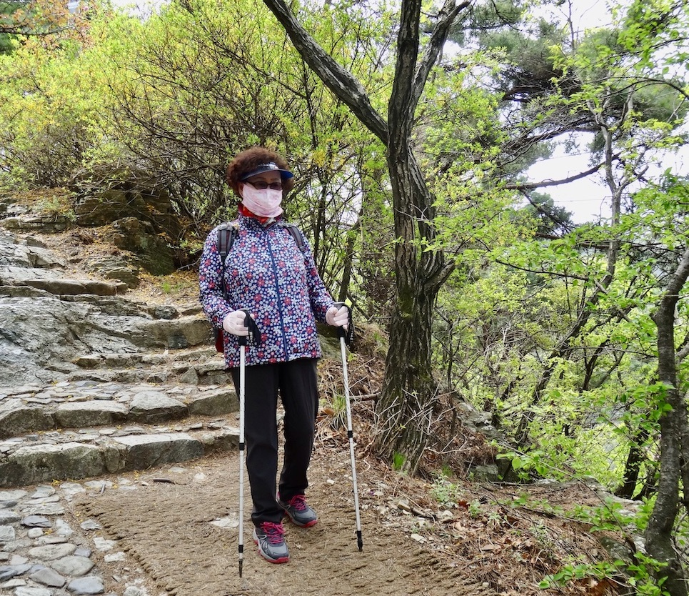 Korean woman hiking on Apsan Mountain.