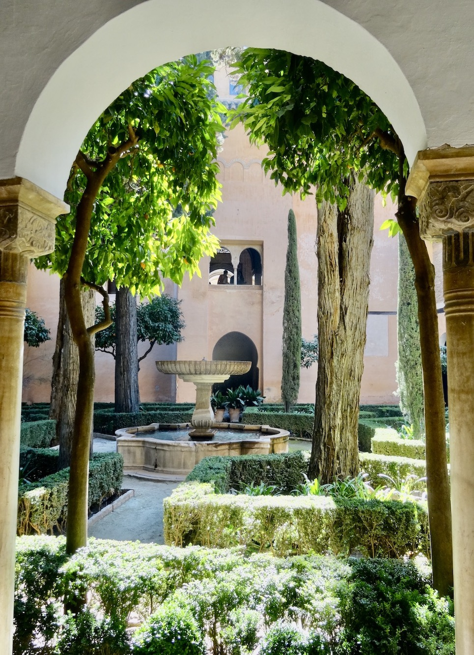 A leafy courtyard in The Alhambra Palace Gardens.