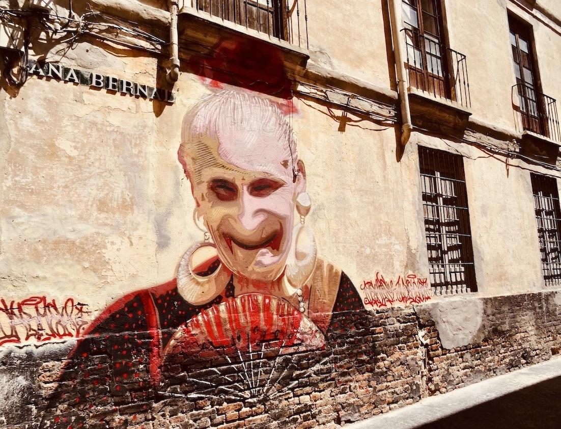 Old woman street mural Malaga.