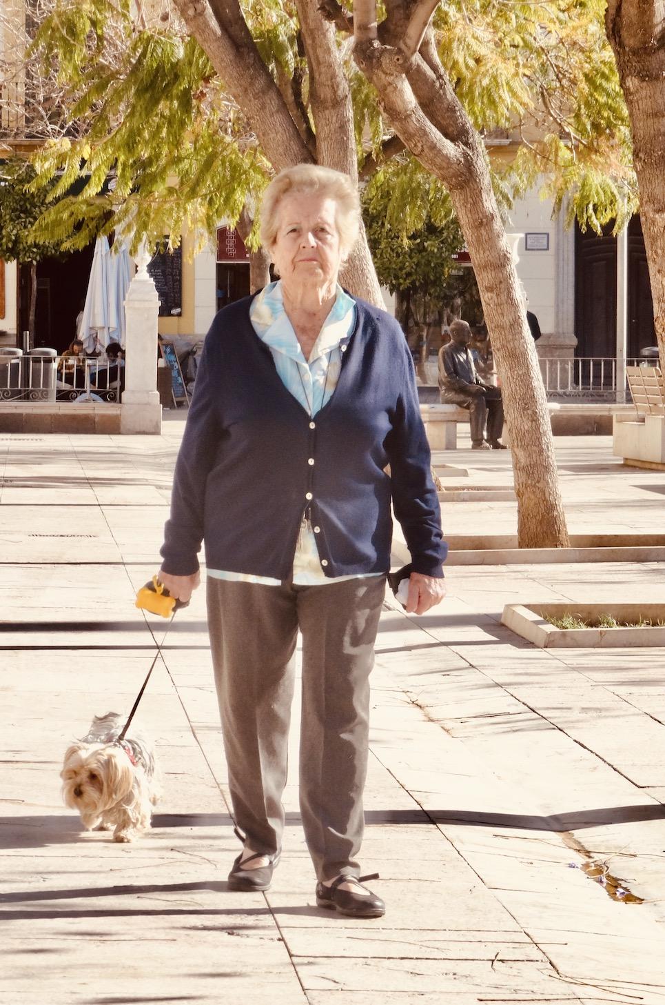 Old woman walking dog Malaga Spain