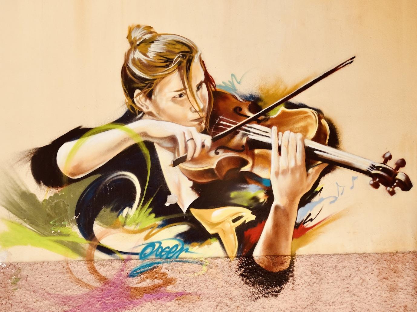Violinist street art Malaga.