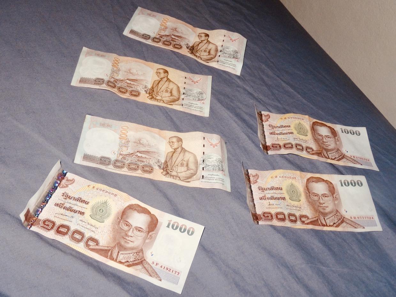 Drying money during Songkran.