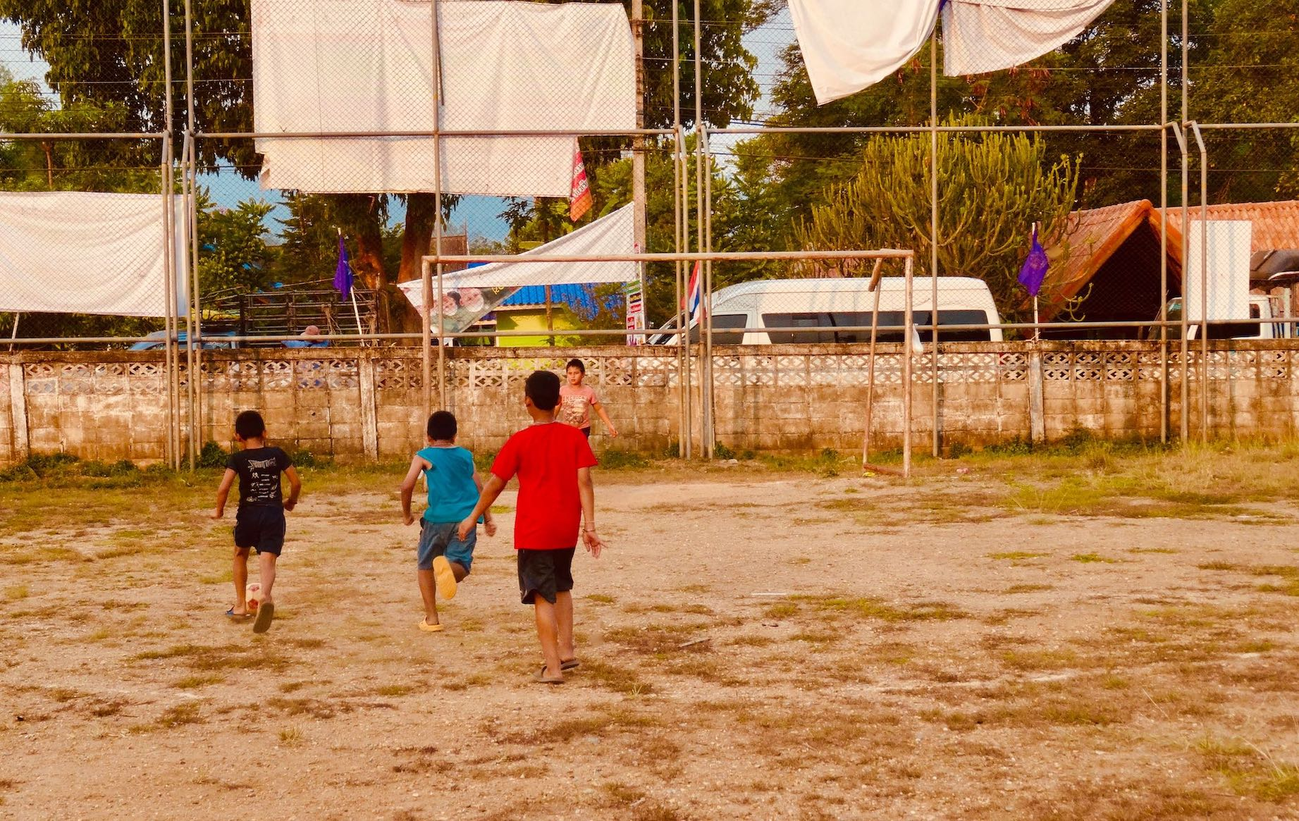 Children playing football Sangkhlaburi Thailand