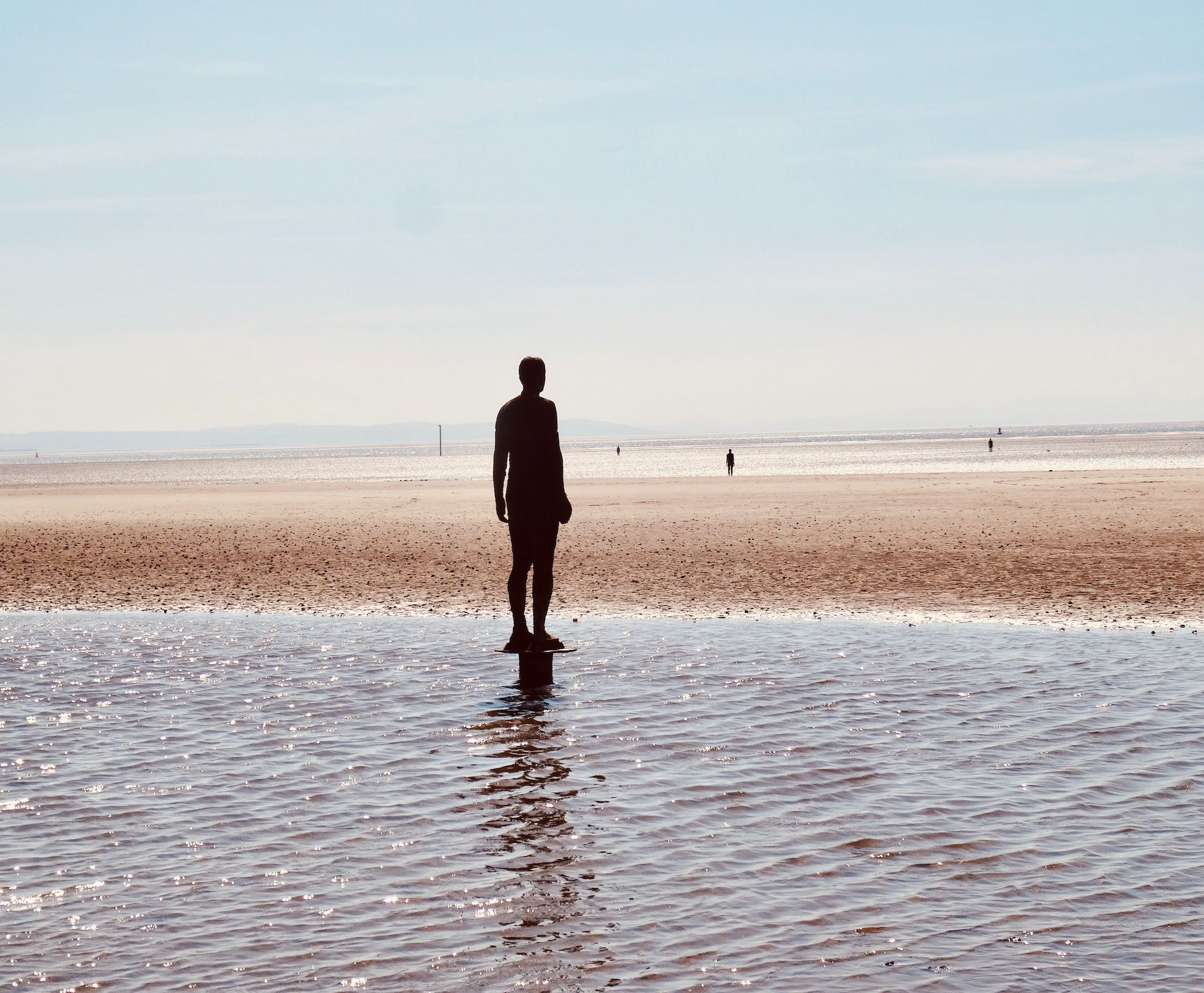 Visit Crosby Beach in Liverpool.