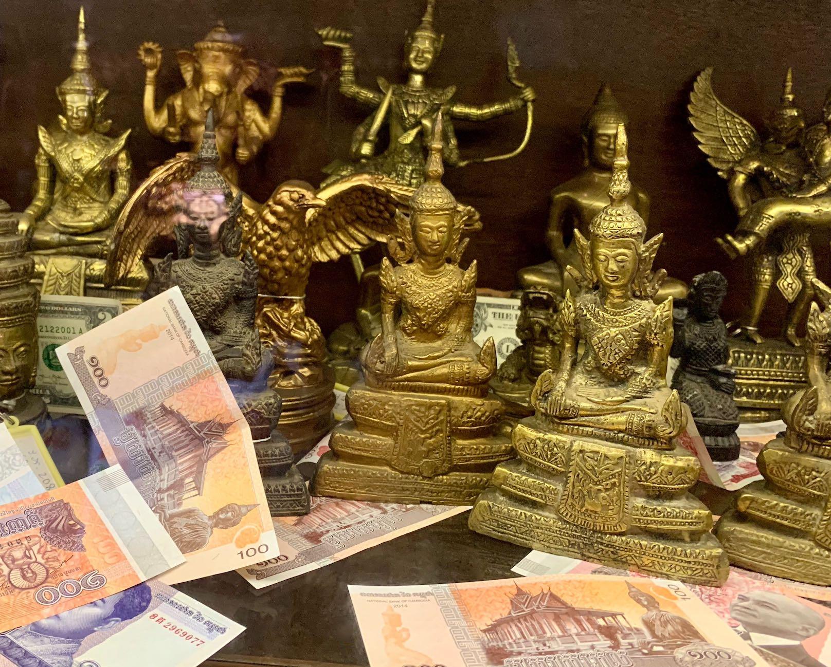 Little golden Buddha statues Phnom Penh