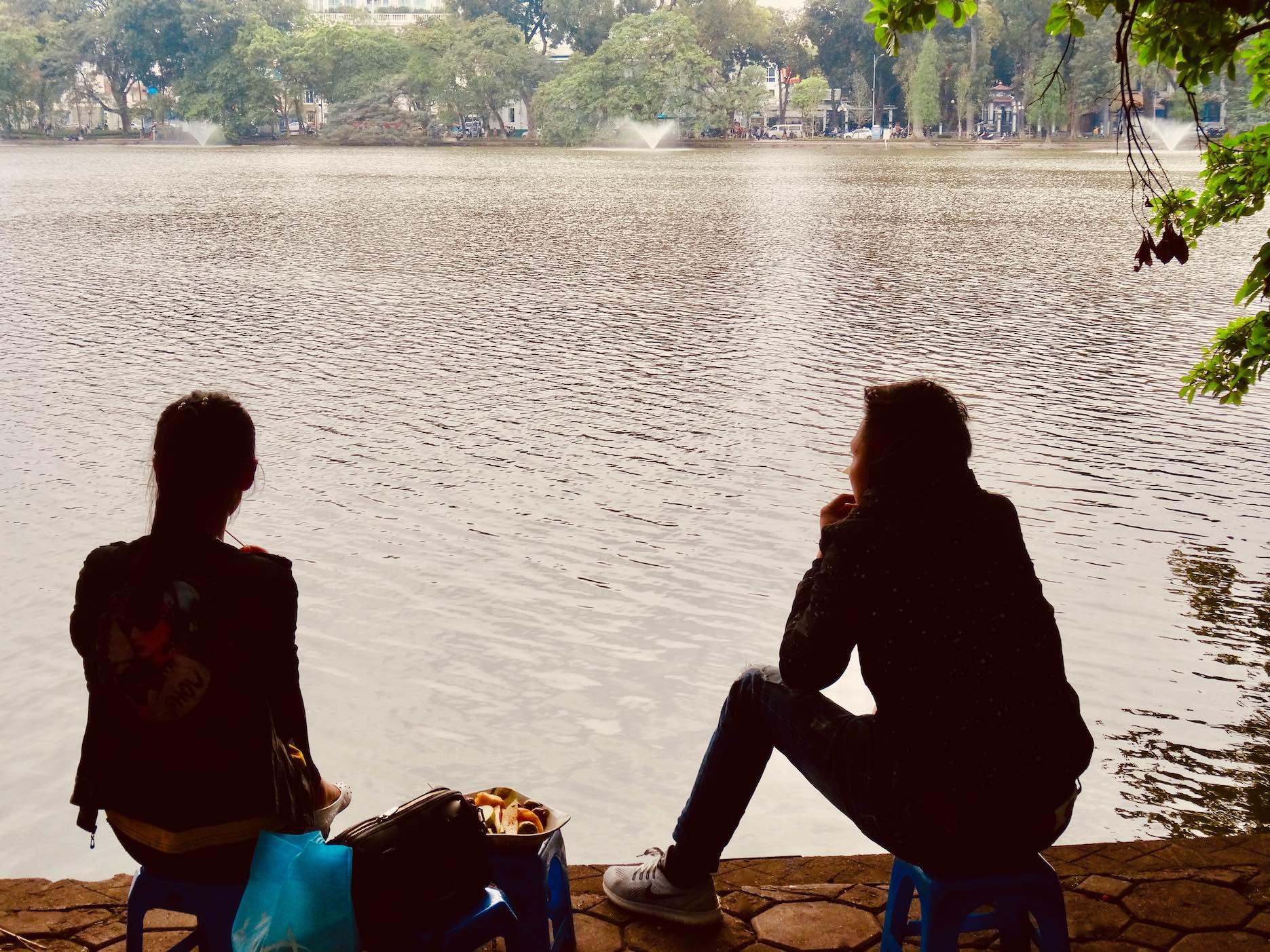 Visit Hoan Kiem Lake in Hanoi.