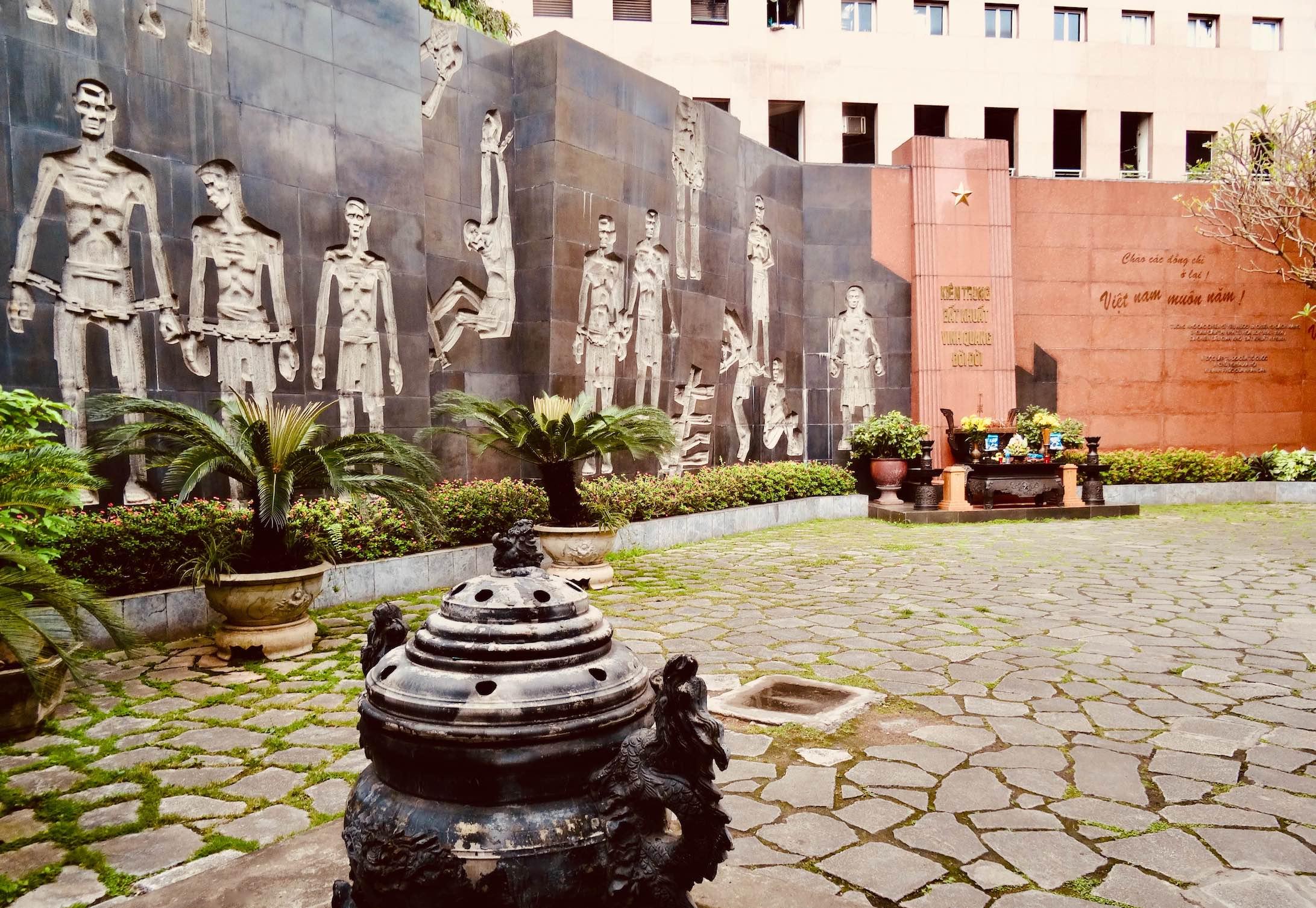 Wall carvings Hoa Lo Prison.