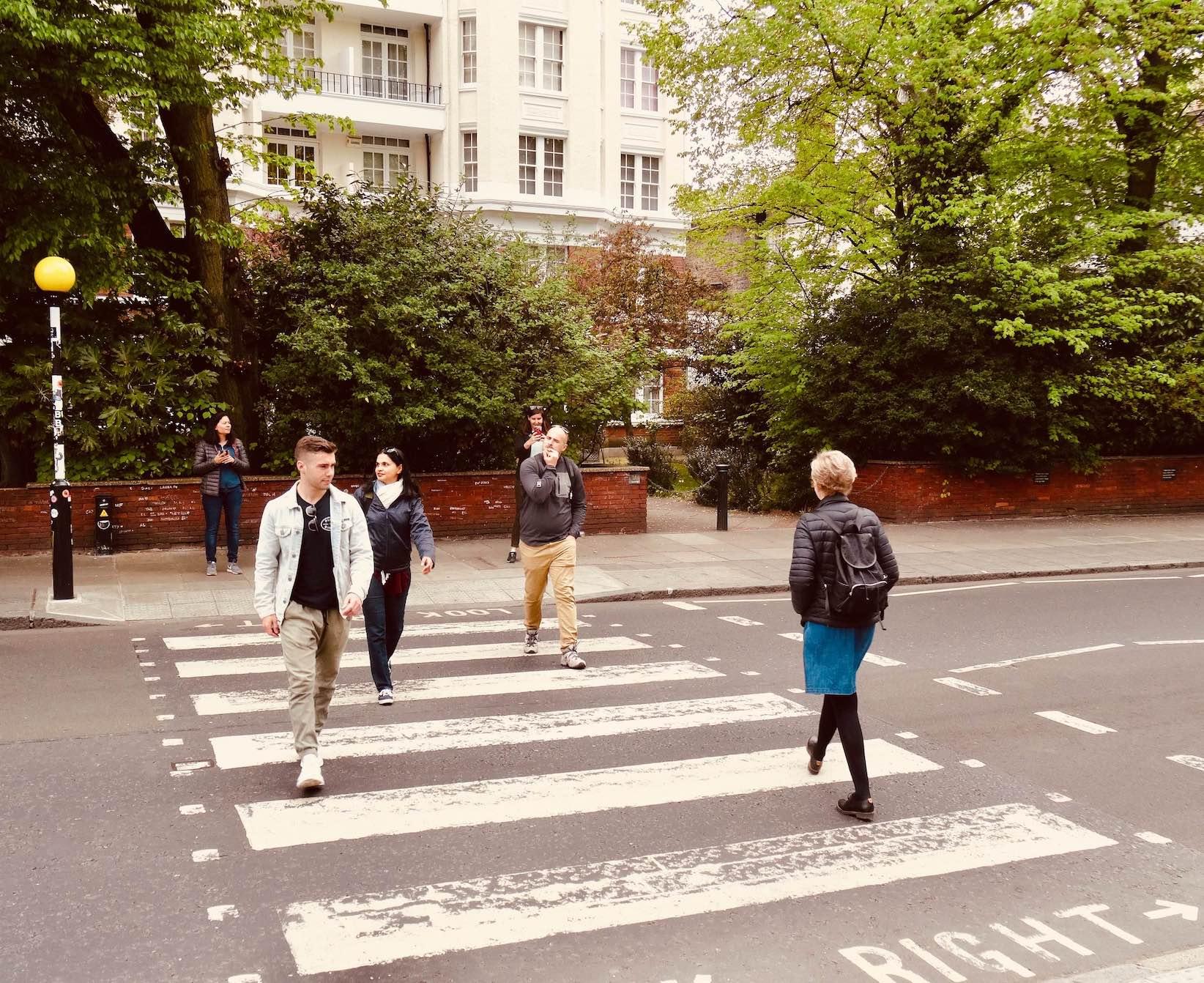 Crossing the Abbey Road zebra crossing in London