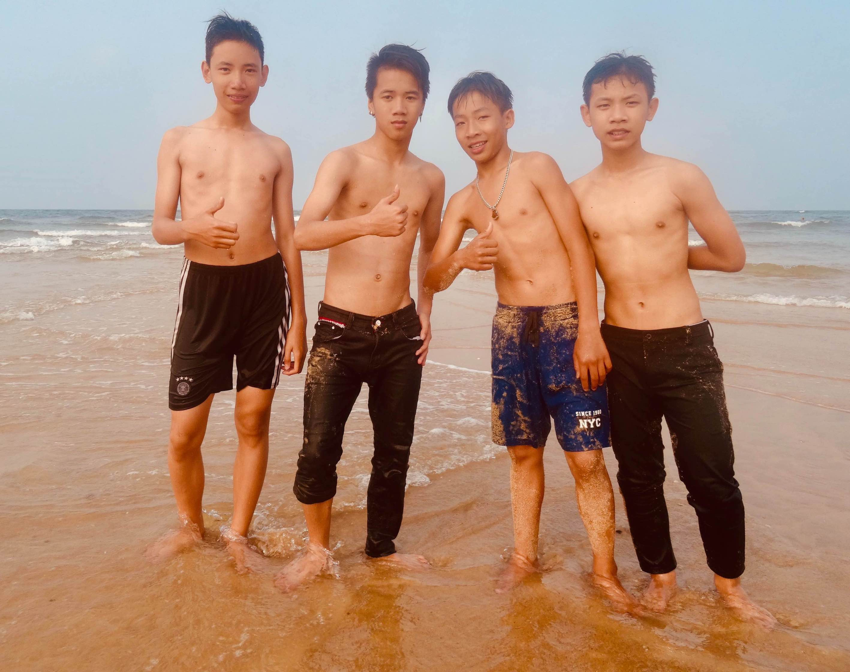 Local boys at the beach Dong Hoi Vietnam