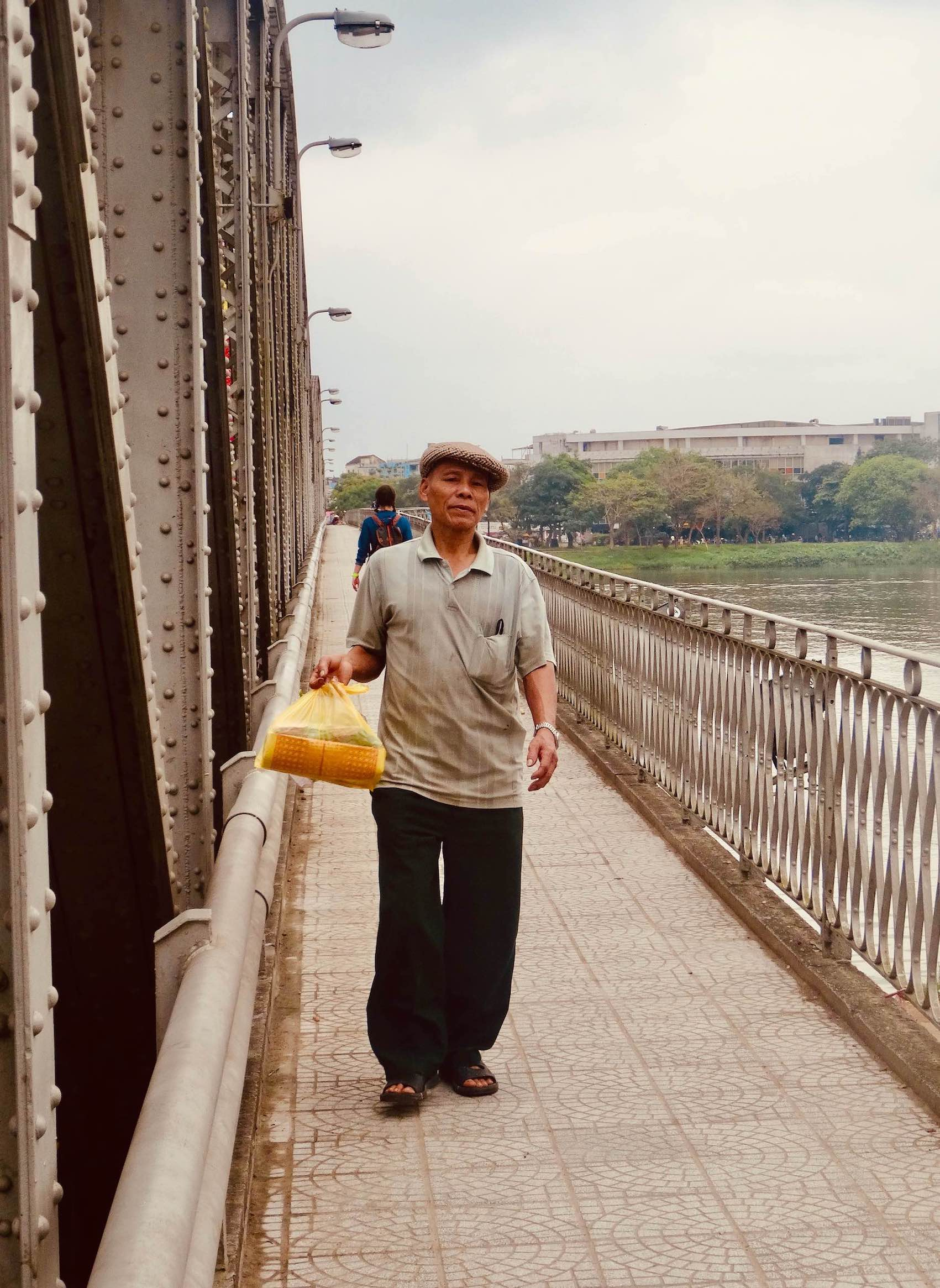 Local man crossing Truong Tien Bridge in Hue