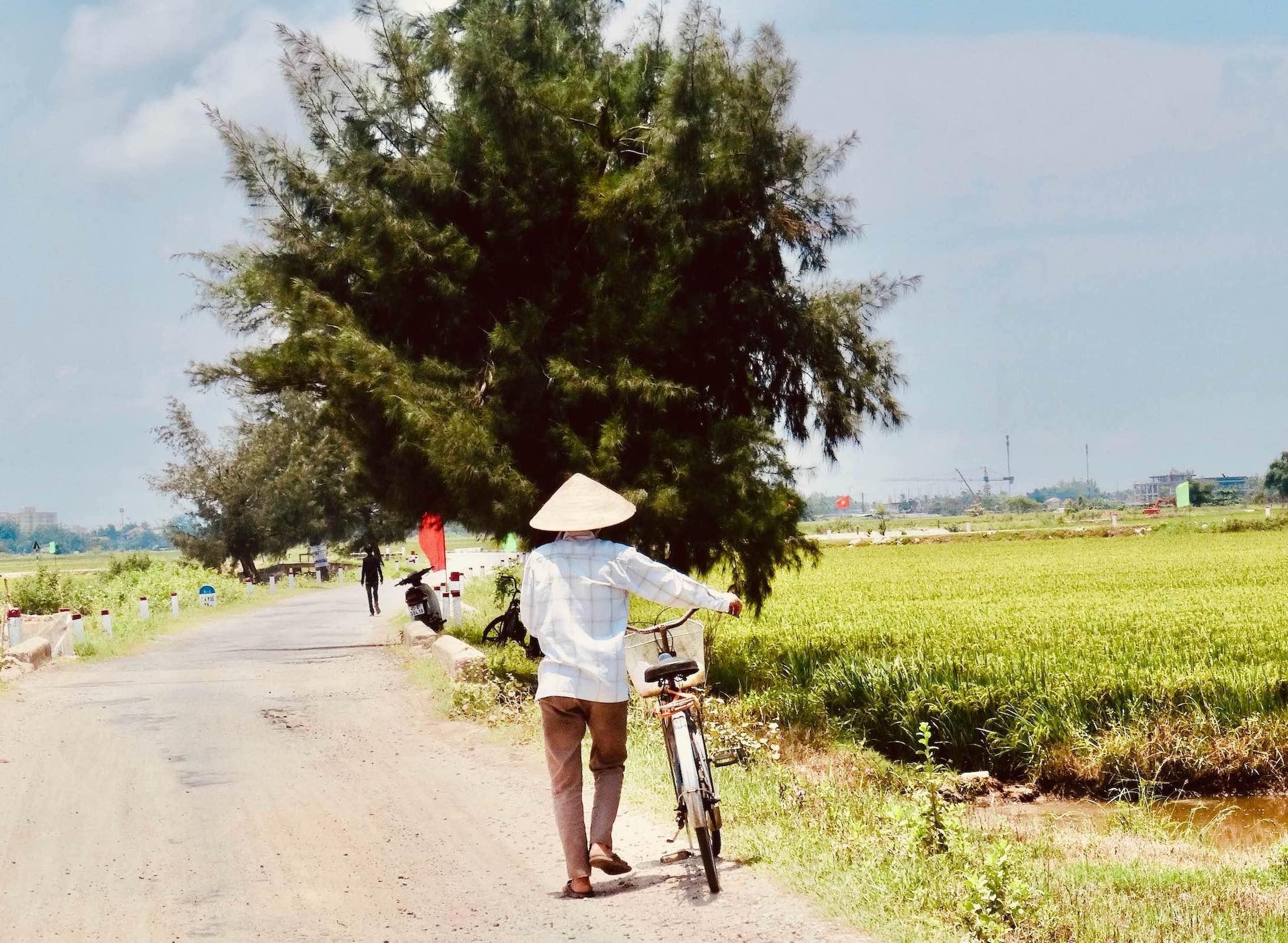 Man and bicycle Hue Vietnam.