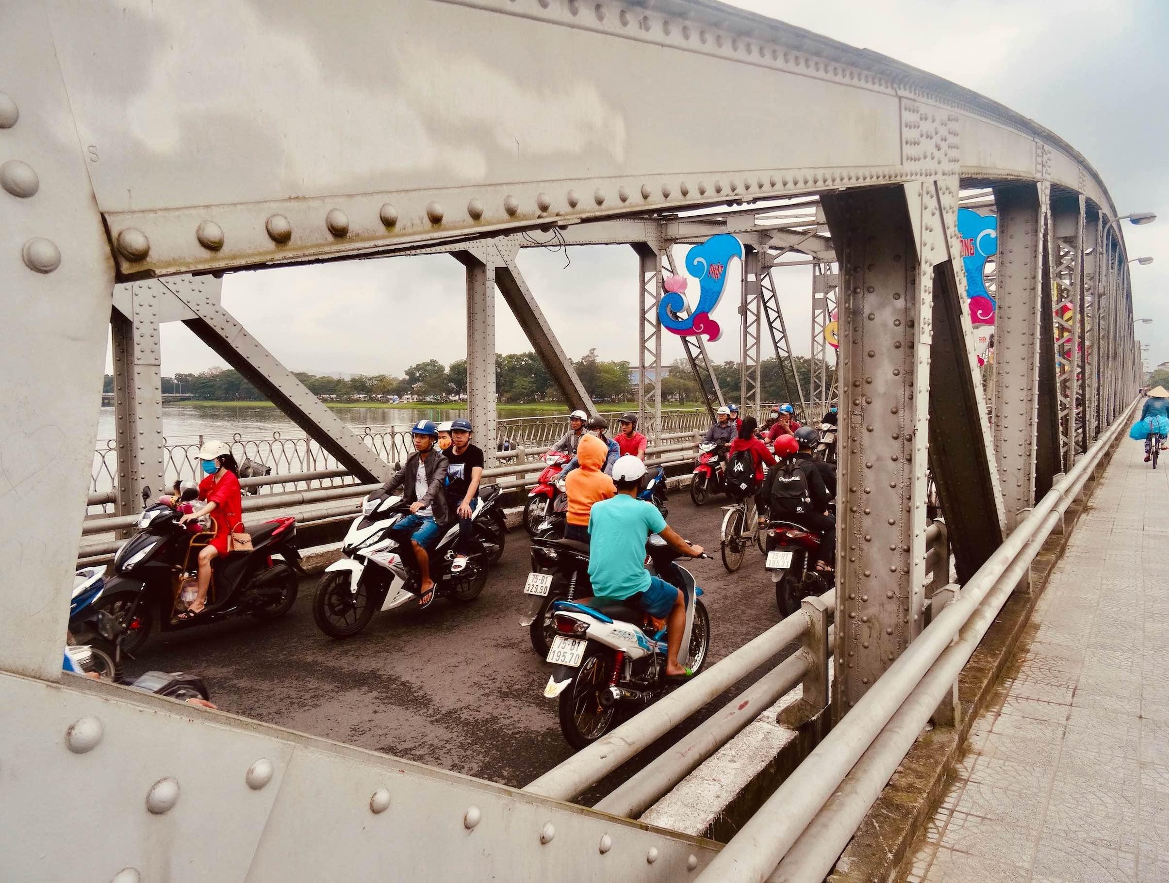Traffic on the Truong Tien Bridge Hue Vietnam